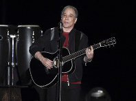 This Sept. 22, 2018 file photo shows singer-songwriter Paul Simon performing in Flushing Meadows Corona Park during the final stop of his Homeward Bound - The Farewell Tour in New York. (Photo by Evan Agostini/Invision/AP)