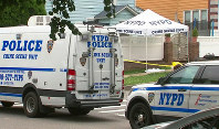 In this image taken from video provided by WABC-TV, New York City Police department vehicles are parked near a crime scene outside Crocheron Park in the Queens borough of New York, on June 18, 2019. (WABC-TV via AP)