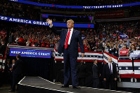 President Donald Trump arrives to speak at his re-election kickoff rally at the Amway Center, on June 18, 2019, in Orlando, Fla. (AP Photo/Evan Vucci)
