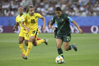 Australia's Sam Kerr, right, scores her side's opening goal during the Women's World Cup Group C soccer match between Jamaica and Australia at Stade des Alpes stadium in Grenoble, France, on June 18, 2019. (AP Photo/Laurent Cipriani)