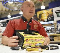 A Super Autobacs Shonan employee holds a sudden acceleration regulator at a shop in Kusatsu, Shiga Prefecture, on June 10, 2019. (Mainichi/Misaki Morokuma)