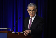 In this June 2, 2019, file photo Federal Reserve Chairman Jerome Powell speaks at a conference involving its review of its interest-rate policy strategy and communications in Chicago. (AP Photo/Kiichiro Sato)