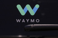 This May 8, 2018 file photo shows a Waymo logo displayed on the window of a car at the Google I/O conference in Mountain View, California. (AP Photo/Jeff Chiu)
