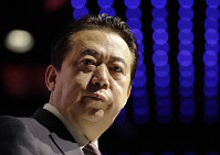 In this July 4, 2017 file photo, then Interpol President Meng Hongwei delivers his opening address at the Interpol World Congress, in Singapore. (AP Photo/Wong Maye-E)