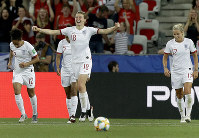 England's Ellen White, front, celebrates after scoring her side's second goal during the Women's World Cup Group D soccer match between Japan and England at the Stade de Nice in Nice, France, on June 19, 2019. (AP Photo/Claude Paris)