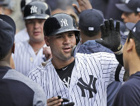 New York Yankees' Gary Sanchez celebrates with teammates after hitting a three-run homer during the first inning of a baseball game against the Tampa Bay Rays at Yankee Stadium, on June 19, 2019, in New York. (AP Photo/Seth Wenig)