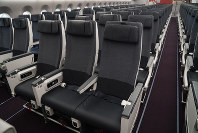 Regular economy class seats are seen on Japan Airlines Co.'s new Airbus A350-900 passenger plane at Tokyo's Haneda Airport on June 20, 2019. The seats are wider than those on Boeing planes. (Mainichi/Masamitsu Kurokawa)