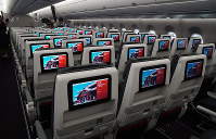 Seatback entertainment systems are seen on Japan Airlines Co.'s new Airbus A350-900 passenger plane, at Tokyo's Haneda Airport on June 20, 2019. Each seat also has an electrical outlet and USB port. (Mainichi/Masamitsu Kurokawa)