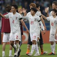 サッカー南米選手権【日本-ウルグアイ】ウルグアイと引き分け、勝ち点1を挙げた日本の選手たち=ブラジル・ポルトアレグレで2019年6月20日、AP