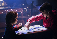 This image released by Orion Pictures shows the character Chucky, left, and Gabriel Bateman in a scene from the horror film,