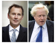 In this two photo file combo image, Jeremy Hunt, left, and Boris Johnson, right, who are the final two contenders for leadership of the Conservative Party, on June 20, 2019. (AP Photo FILE/Matt Dunham, Frank Augstein)