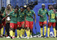 Cameroon players celebrate after scoring the opening goal during the Women's World Cup Group E soccer match between Cameroon and New Zealand at the Stade de la Mosson in Montpellier, France, on June 20, 2019. (AP Photo/Claude Paris)