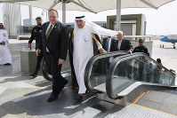 U.S. Secretary of State Mike Pompeo, left, walks with Saudi Foreign Minister Ibrahim Abdulaziz Al-Assaf, as Pompeo arrives in Jeddah, Saudi Arabia, on June 24, 2019. (AP Photo/Jacquelyn Martin, Pool)