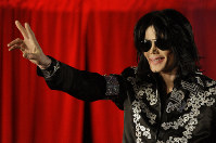 This March 5, 2009 file photo shows Michael Jackson as he announces 10 live concerts at the London O2 Arena in south London. (AP Photo/Joel Ryan)