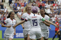 United States' Megan Rapinoe, front, celebrates with teammates after scoring the opening goal from a penalty kick during the Women's World Cup round of 16 soccer match between Spain and US at the Stade Auguste-Delaune in Reims, France, June 24, 2019. (AP Photo/Alessandra Tarantino)