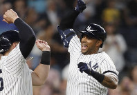 New York Yankees' Aaron Hicks, right, celebrates with designated hitter Luke Voit, after they scored on Hicks' three-run home run during the fifth inning of a baseball game against the Toronto Blue Jays on June 24, 2019, in New York. (AP Photo/Kathy Willens)