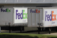 FedEx trailers are shown at a loading dock in Greensboro, N.C., on June 25, 2019. (AP Photo/Chuck Burton)