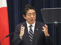 Japanese Prime Minister Shinzo Abe speaks during a press conference at the prime minister's office in Tokyo, on June 26, 2019. (AP Photo/Koji Sasahara)