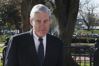 In this March 24, 2019 photo, then-special counsel Robert Mueller walks past the White House, after attending St. John's Episcopal Church for morning services, in Washington. (AP Photo/Cliff Owen)