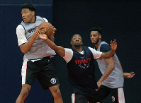Washington Wizards first round draft pick Rui Hachimura, left, grabs a rebound during the NBA basketball team's minicamp at the MedStar Wizards Performance Center in Washington, on June 25, 2019. (John McDonnell/The Washington Post via AP)