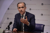 In this May 2, 2019, file photo Mark Carney the Governor of the Bank of England speaks during an Inflation Report Press Conference at the Bank of England in the City of London. (AP Photo/Matt Dunham, Pool)