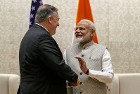 Secretary of State Mike Pompeo, left, shakes hands with Indian Prime Minister Narendra Modi, during their meeting at the Prime Minister's Residence in New Delhi, India, on June 26, 2019. (AP Photo/Jacquelyn Martin, Pool)