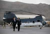 Secretary of State Mike Pompeo, left, walks from a helicopter with U.S. Ambassador to Afghanistan John Bass, on June 25, 2019, as Pompeo returns to his plane after an unannounced visit to Kabul, Afghanistan. (AP Photo/Jacquelyn Martin, Pool)