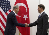 Acting U.S. Secretary for Defense Mark Esper, right, greets Turkish Defense Minister Hulusi Akar prior to a meeting of NATO defense ministers at NATO headquarters in Brussels, on June 26, 2019. (AP Photo/Virginia Mayo, Pool)