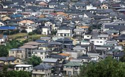 住宅密集地の中に空き家が潜んでいるかもしれない(Bloomberg)
