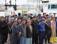 Crewmen of small whaling boats attend a ceremony marking the resumption of commercial whaling at the port in Kushiro, Hokkaido, on July 1, 2019. (Mainichi/Taichi Kaizuka)