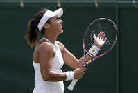 Britain's Heather Watson celebrates after beating United States' Caty McNally to win their women's singles match during day one of the Wimbledon Tennis Championships in London, on July 1, 2019. (AP Photo/Ben Curtis)