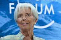 In this Jan. 4, 2019 file photo, International Monetary Fund Managing Director Christine Lagarde attends a session of the annual meeting of the World Economic Forum in Davos, Switzerland. (AP Photo/Markus Schreiber)
