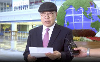 In this image made from a video taken on July 6, 2019, by North Korean Uriminzokkiri state-run website, shows the son of the highest-profile South Korean ever to defect to North Korea, Choe In-guk giving a statement to media as he arrived in the North to permanently resettle. (Uriminzokkiri via AP)