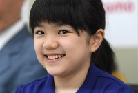 Sumire Nakamura smiles during a press conference following her first official match victory since her debut as a professional Go player in April, in Osaka's Kita Ward on July 8, 2019. (Mainichi/Rei Kubo)