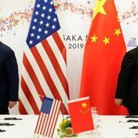 G20サミットに合わせて行われたトランプ米大統領(左)と中国の習近平国家主席の首脳会談=大阪市で6月29日、ロイター