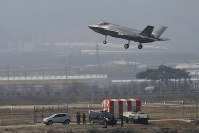 In this March 29, 2019 photo, a U.S. F-35A fighter jet prepares to land at an air base in Chungju, South Korea. (Kang Jong-min/Newsis via AP)