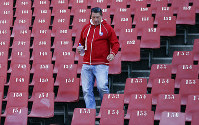 This June 24, 2015, file photo shows former rugby player James Small walking down the stairs during the 1995 Rugby World Cup-winning team reunion at Ellis Park stadium in Johannesburg, South Africa. (AP Photo/Themba Hadebe)