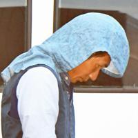 粕屋警察署から送検される古賀哲也容疑者=福岡県粕屋町で2019年7月16日午前9時18分、上入来尚撮影