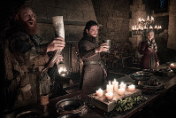 This image released by HBO shows, from left, Kristofer Hivju, Kit Harington and Emilia Clarke in a scene from