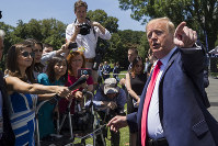 President Donald Trump talks with the press, during a Made in America showcase event on the South Lawn of the White House, on July 15, 2019, in Washington. (AP Photo/Alex Brandon)