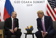 n this June 28, 2019, file photo, President Donald Trump, right, meets with Russian President Vladimir Putin during a bilateral meeting on the sidelines of the G-20 summit in Osaka, Japan. (AP Photo/Susan Walsh)