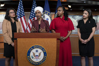 From left, U.S. Reps. Rashida Tlaib, D-Mich., Ilhan Omar, D-Minn., Ayanna Pressley, D-Mass., and Alexandria Ocasio-Cortez, D-N.Y., respond to base remarks by President Donald Trump, who called for four Democratic congresswomen of color to go back to their