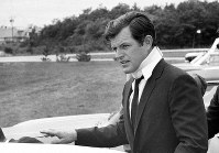 In this July 22, 1969 file photograph, U.S Sen. Edward Kennedy, D-Mass., arrives back home in Hyannis, Mass., after attending the funeral of Mary Jo Kopechne in Pennsylvania. (AP Photo/Frank C. Curtin)