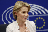 German Ursula von der Leyen talks to journalists during a news conference following her election as new European Commission President at the European Parliament in Strasbourg, eastern France, on July 16, 2019. (AP Photo/Jean-Francois Badias)