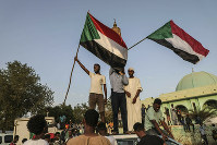 In this July 5, 2019 photo, Sudanese people celebrate in the streets of Khartoum after ruling generals and protest leaders announced they have reached an agreement on the disputed issue of a new governing body. (AP Photo)