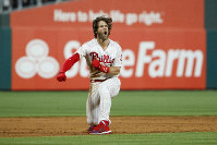 Philadelphia Phillies' Bryce Harper celebrates after hitting a game-winning two-run double off Los Angeles Dodgers relief pitcher Kenley Jansen during the ninth inning of a baseball game on July 16, 2019, in Philadelphia. (AP Photo/Matt Slocum)