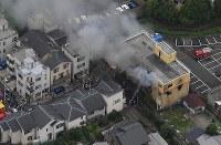 The Kyoto Animation building is seen on fire in Kyoto's Fushimi Ward on July 18, 2019. (Mainichi/Naohiro Yamada)