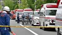 Emergency vehicles are seen lined up near the scene of the deadly arson attack in Kyoto's Fushimi Ward on July 18, 2019. (Mainichi/Ai Kawahira)