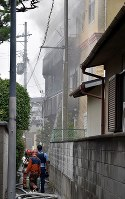 The Kyoto Animation building is seen on fire in Kyoto's Fushimi Ward on July 18, 2019. (Mainichi/Ai Kawahira)
