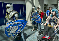 In this July 19, 2018, file photo, attendees Michael Mijerark, left, and Ryan Trent, center, dress as knights from